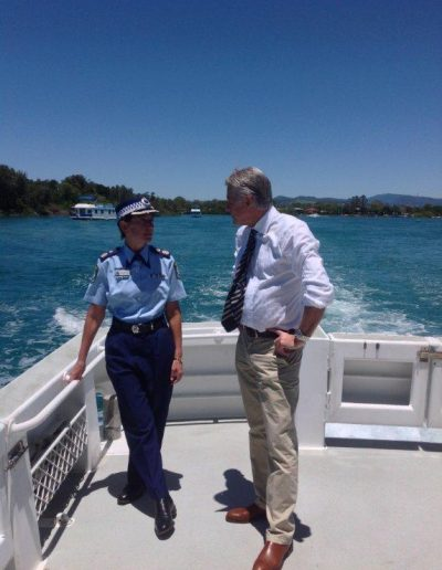 Deputy Police Commissioner Catherine Burn and Geoff Provest on theTweed River