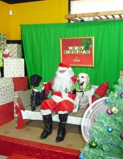 Dressed up as Santa for another year for Friends of the Pound. Community members came along with their animals for photos with Santa.