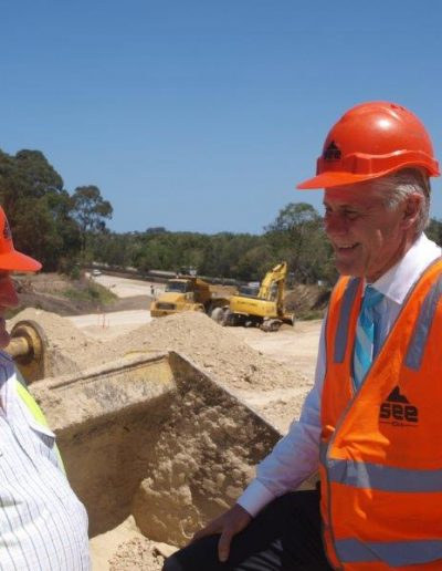 Geoff Provest and Tweed Shire Councillor Warren Polglase inspect progress at the new Kirkwood Road Pacific Highway interchange.