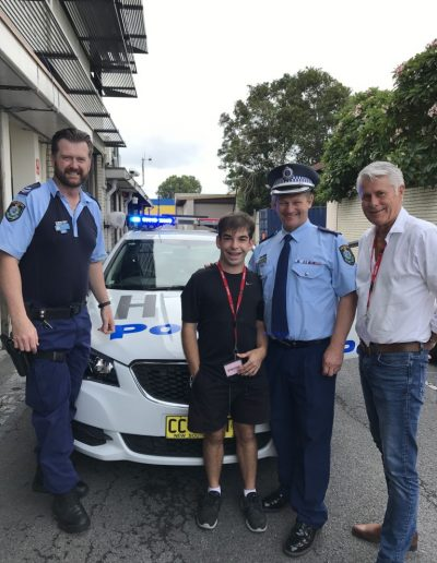 Liam visits Tweed Byron LAC. Pictured here with Crime Prevention Officer, Brad Foster and Superintedent Wayne Starling