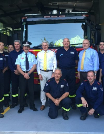 Minister Elliot pictured here with Tweed Heads Fire Station officers and Zone Commander RN2 Superintendent Greg Lewis