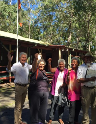 Official title deeds for Lot 490 are handed back to the Traditional Owners