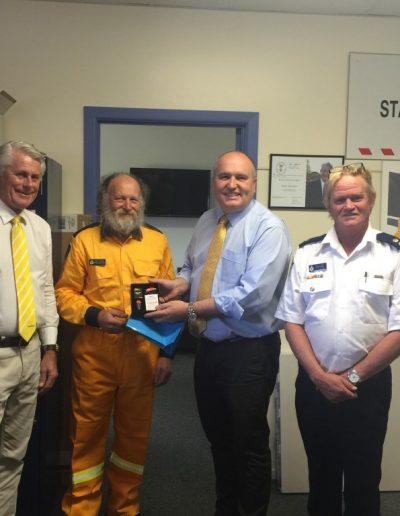 Presenting longstanding member Peter Harriden with his farewell present from his team and thank him for his dedication and service at the Far North Coast Fire Control Centre