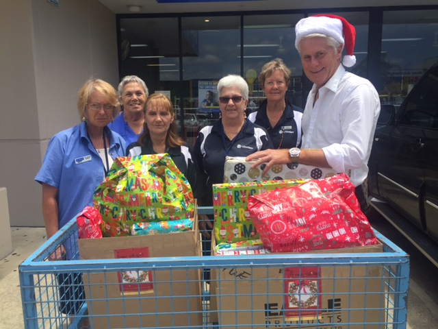 The team at Vinnies accepting the presents for the family my office adopted.