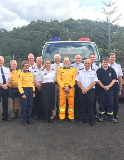The team at the Far North Coast Fire Control Centre with Minister David Elliot